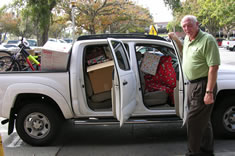 Santa's Sleigh was busy so Ray Milligan, with Catholic Charities, stopped by to pick up gifts for five families that were donated by faculty, staff and students of the student dental clinics.