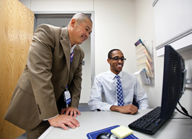 Dr. Brian Hoh, a UF neurosurgeon, mentors fourth-year medical student Chris Newman