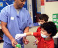 Senior D.M.D. students presented oral health information to local school students.