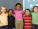 row of kids in classroom full width web