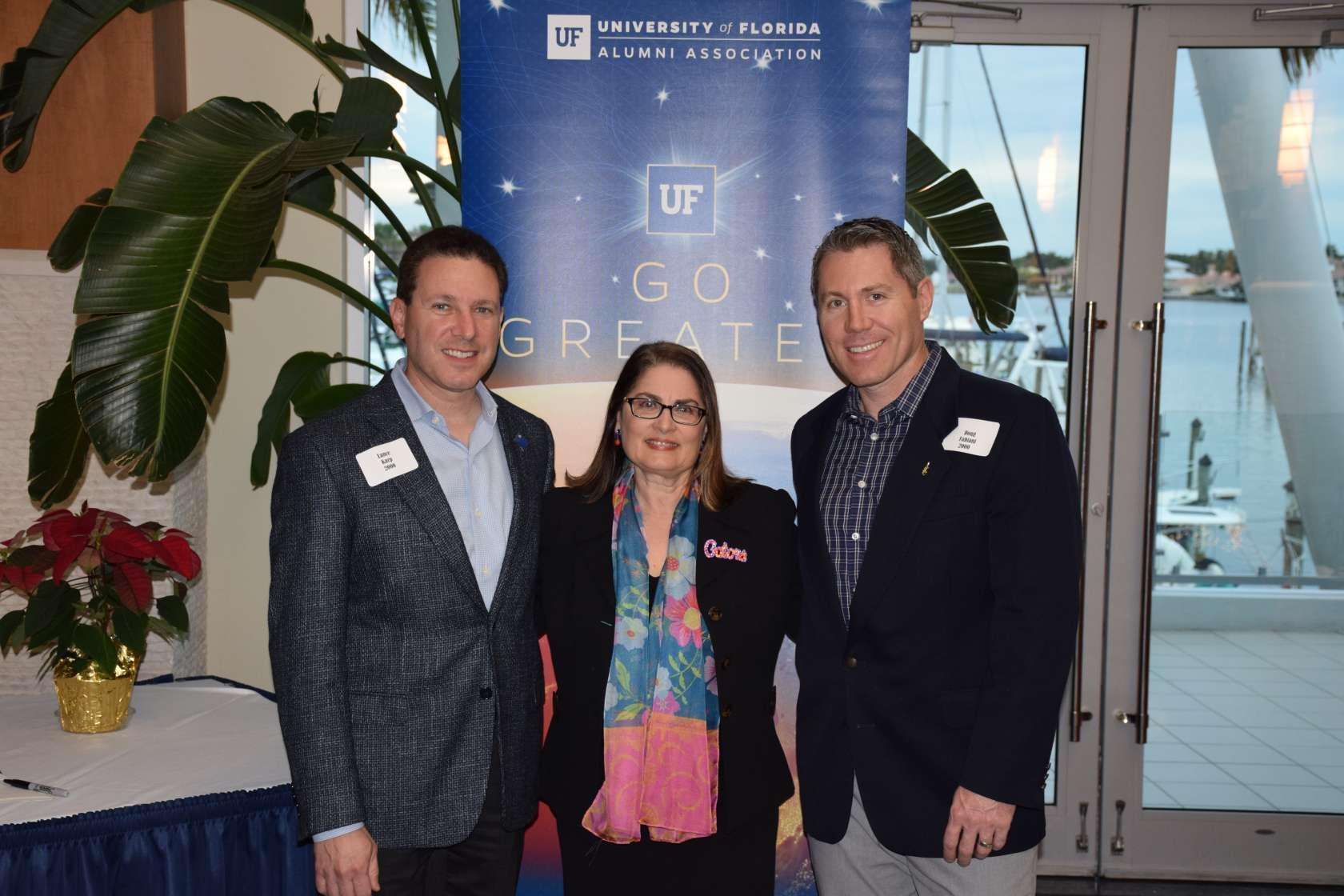 Dean Isabel Garcia alongside Dr. Lance Karp, left, and Dr. Doug Fabiani, right, at the college's 2018 Sarasota Gator Dentist Gathering.