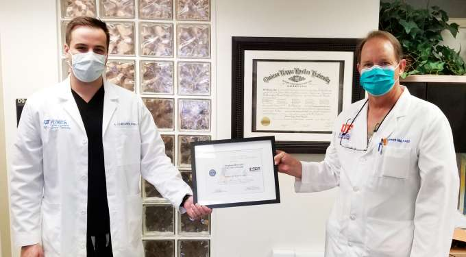 Dr. Andrew Corsaro, left, and Dr. Stephen Howard proudly display the Patriot Award.