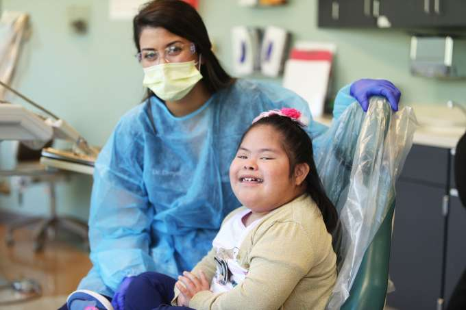 Special needs patient smiling at UF's NCEF Pediatric Dental Center.